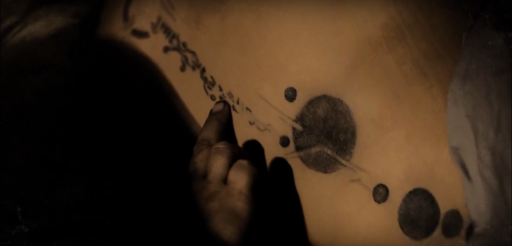 lexa back tattoo