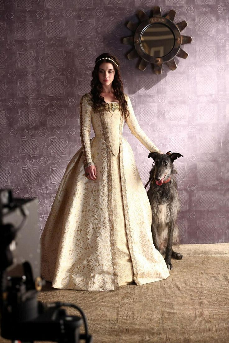 Adelaide Kane as Mary Queen of Scots with her beloved royal dog.